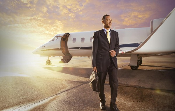 Businessman in front of a private airplane